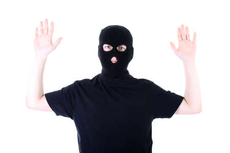 The surrendered criminal in a black mask Stock Photo