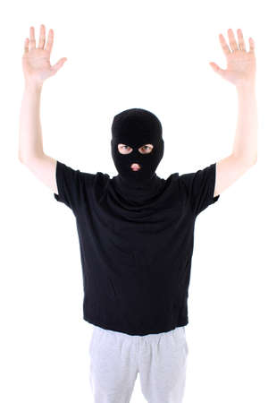 assasin: The surrendered criminal in a black mask Stock Photo