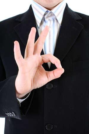 Businessmans hand doing an ok sign photo