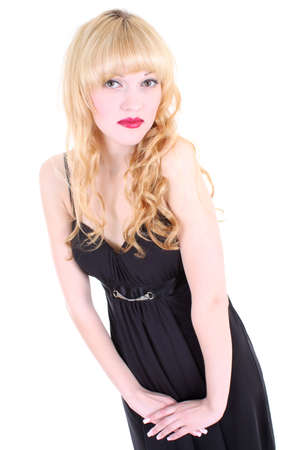 constraining: beautiful girl in black dress with red lips Stock Photo