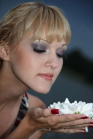 portrait of blond woman with white flower photo