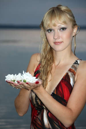 blond woman with white flower photo