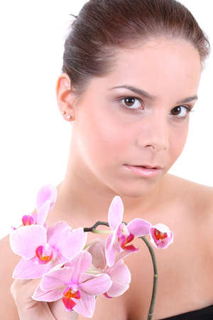 Portrait of a young beautiful healthy woman with orchid Stock Photo - 7666887