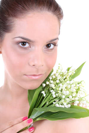 Portrait of a young beautiful healthy woman with flowers photo