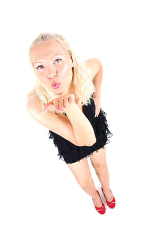 air kiss: bright picture of young blonde in black dress sending an air kiss