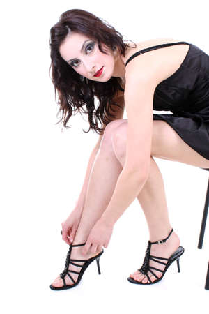 brunette with red lips and smoky eyes in black dress sitting Stock Photo - 7753770