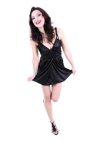 brunette with red lips and smoky eyes in black dress laughing