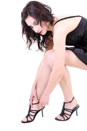 brunette with red lips and smoky eyes in black dress sitting photo