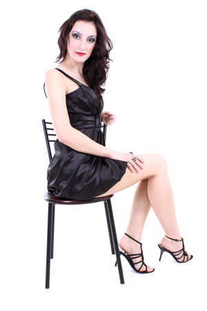 sexy woman with red lips and smoky eyes in black dress sitting photo