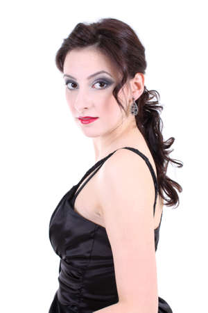 portrait of a brunette with red lips and smoky eyes in black dress photo
