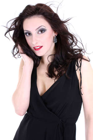 portrait of a brunette with red lips and smoky eyes in black dress