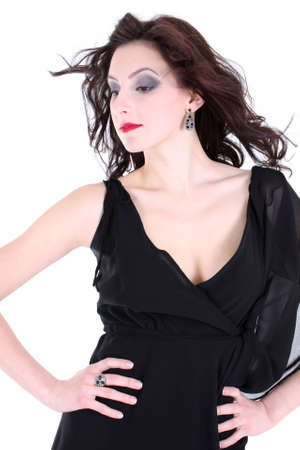 sexy woman with red lips and smoky eyes in black dress posing Archivio Fotografico