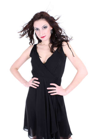 brunette with red lips and smoky eyes in black dress posing