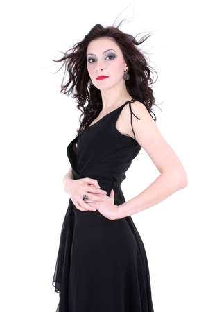 brunette with red lips and smoky eyes in black dress photo
