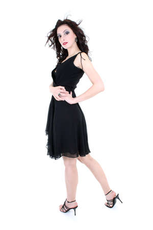 brunette with red lips and smoky eyes in black dress posing photo