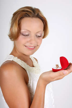 smiling woman with wedding rings photo