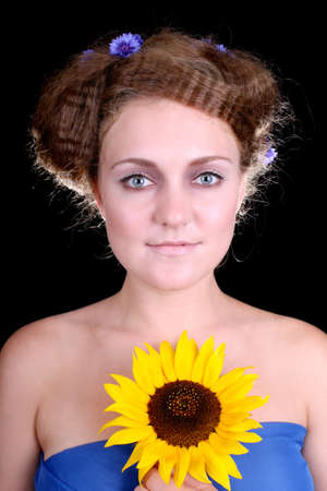 Beautiful woman with sunflower looking in camera Stock Photo - 7859872
