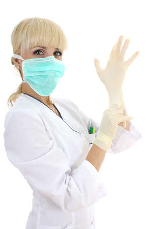 attractive surgeon woman in mask and rubber gloves over white Stock Photo