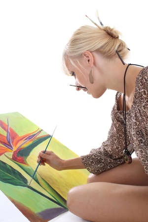 young attractive woman painting a picture photo