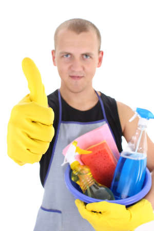 young man with cleaning supplies giving thumbs up. focus on hand Stock Photo