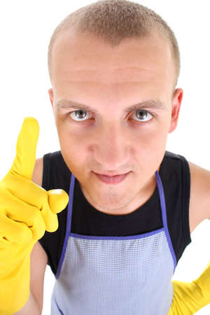 portrait of funny young man in yellow gloves having an idea photo