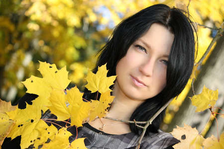leafage: young attractive woman with yellow leafage