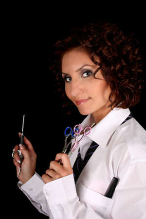 hair stylist with scissors isolated over black photo