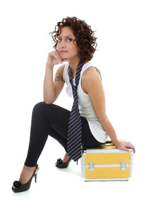 attractive woman sitting with golden toolbox over white photo
