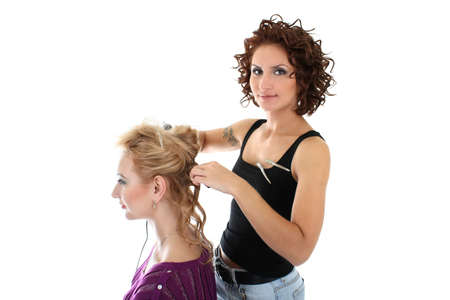 beautiful hairdresser with client isolated over white Stock Photo - 8050157