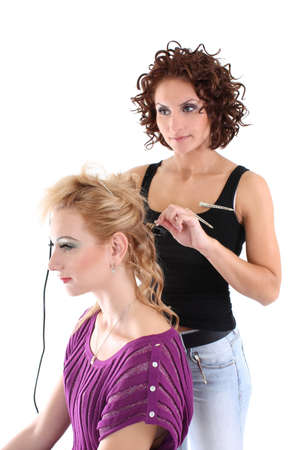 beautiful hairdresser with client isolated over white photo