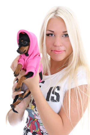 young glamorous woman with toy-terrier over white background photo