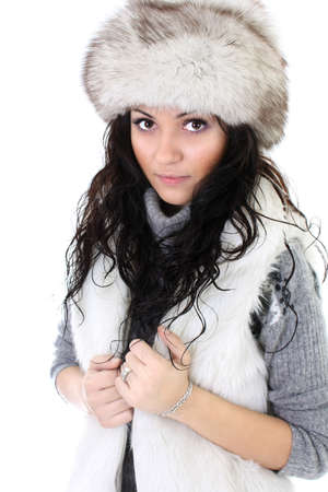 attractive woman in fur hat isolated over white background photo