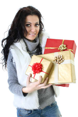 attractive woman in fur vest with presents over white background photo