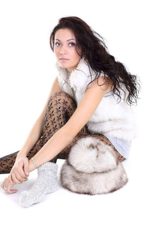 long socks: beautiful woman with fur hat  sitting over white background