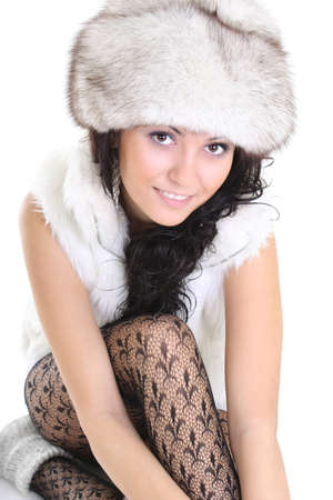 young attractive woman in fur hat isolated over white background photo