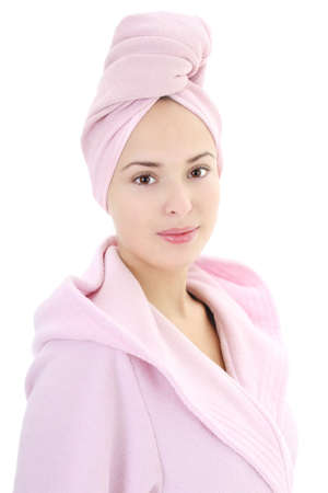 Young beautiful woman in bathrobe with towel on head after bath Stock Photo