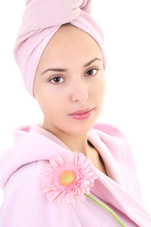 Young beautiful woman in bathrobe with gerberas after bath photo