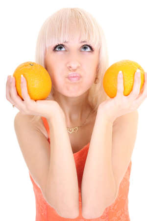 young attractive woman with two oranges isolated over white background photo