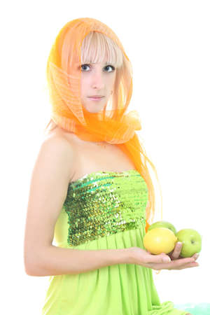 attractive blonde with two apples and lemon over white photo