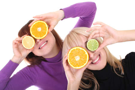 two funny women with orange and lime slices instead of eyes white background Stock Photo