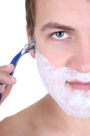 young man shaving with razor close up isolated over white photo
