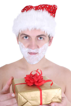 young man with shaving foam in santa hat isolated over white photo