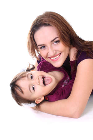Smiling mother and daughter in violet over white photo