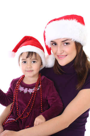 Happy mother and daughter in santa hat over white photo