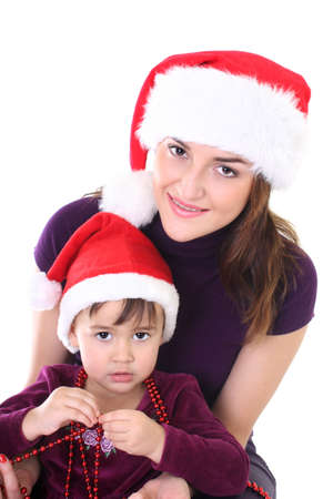 Happy mother and daughter in santa hat photo