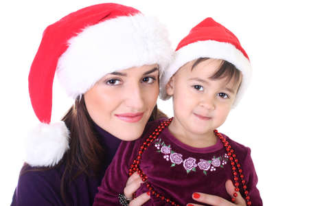 Happy mother and daughter in santa hat over white Stock Photo - 8412058