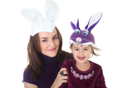 Mother and daughter in masquerade mask over white photo