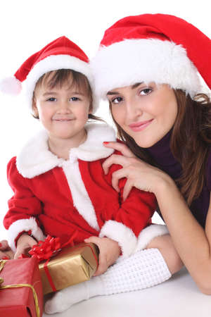 Happy mother and daughter in santa hat with gifts Stock Photo - 8412078