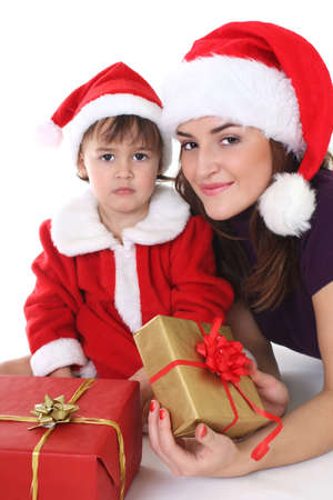 Happy mother and daughter in santa hat with gifts photo
