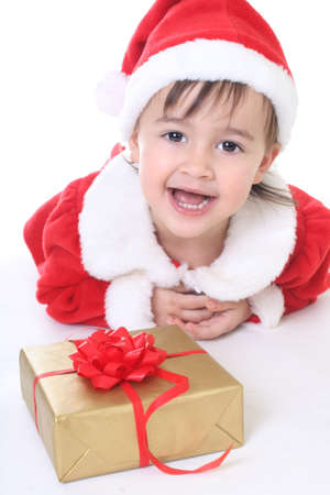 Portrait of smilinig girl in santa clothes with gift Stock Photo - 8412102